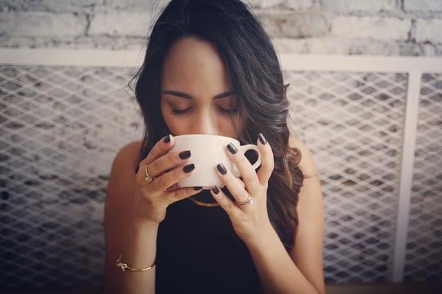 costa rican girl drink coffee